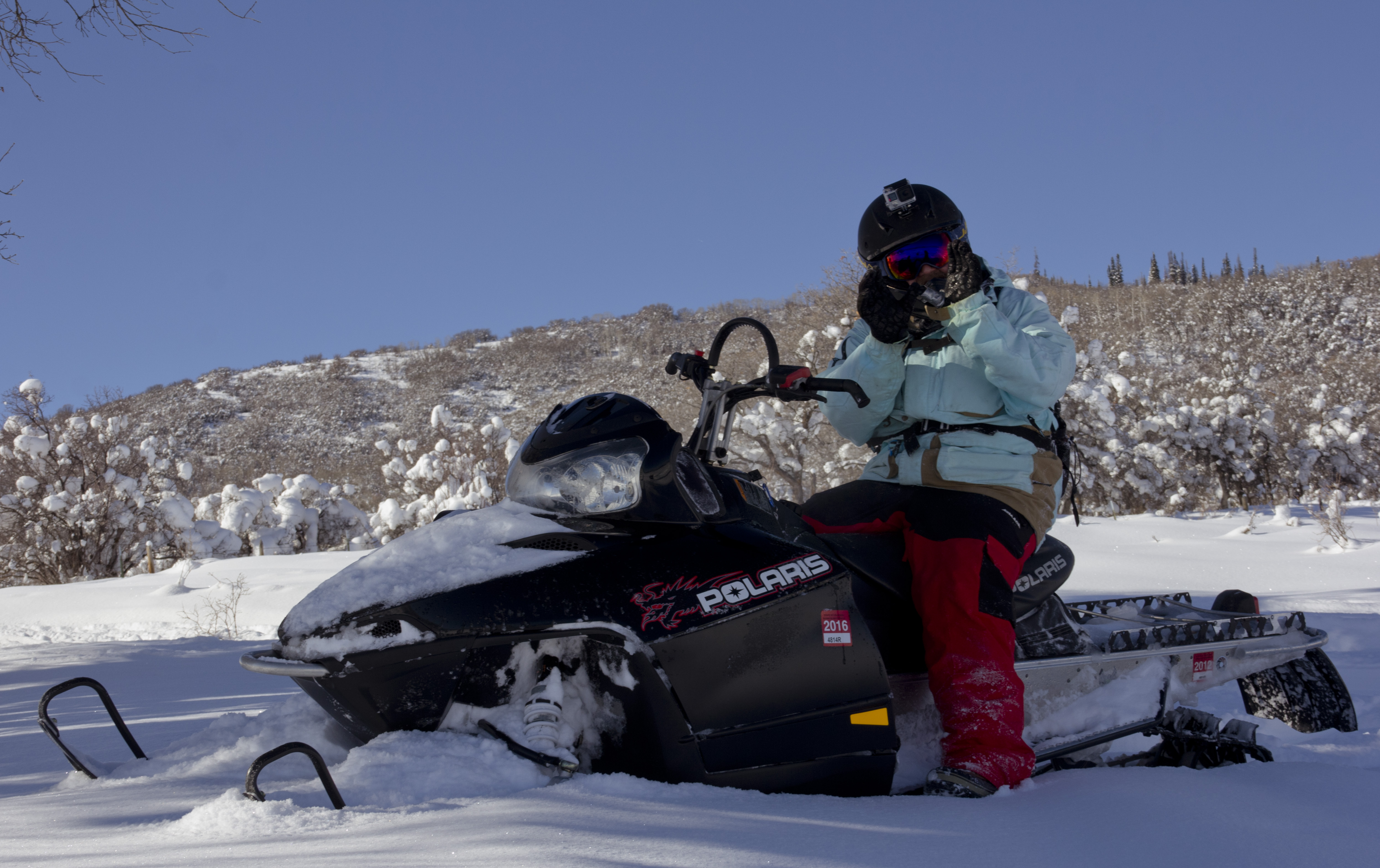 Snowmobiling on the last day of 2015 with Jake Nelson sitting in the shadows